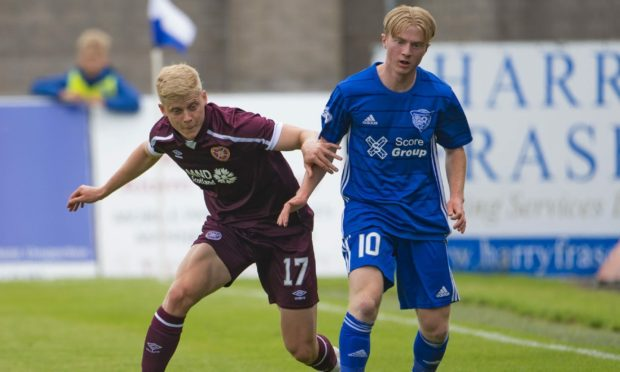 Lyall Cameron in action against Hearts.