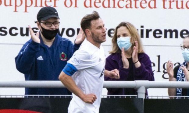 Mitch Megginson celebrates netting against Inverness.
