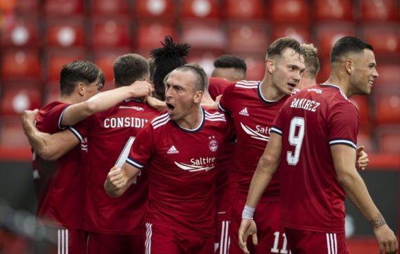 Aberdeen captain Scott Brown (centre) celebrates Andrew Considine's opener against BK Hacken.