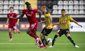 Aberdeen's Jay Emmanuel-Thomas and Alexander Faltsetas in action.