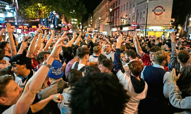 Fans react in London after England won the Euro 2020 semifinal match.