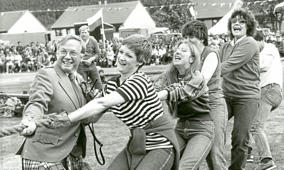 1982 - Helping hand during the Ballater Games tug o' war from games committee secretary Rupert MacNamee, left, for the Air Call Communications team from Tullos, Aberdeen, headed by secretary Valerie Boyko