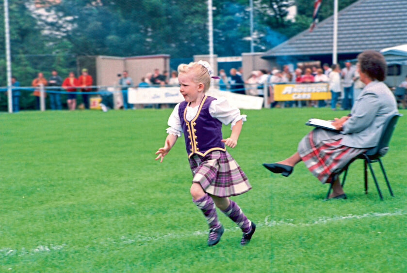 1997 - Five-year-old Samantha Leslie, of Westhill, runs to the platform in time for her dance