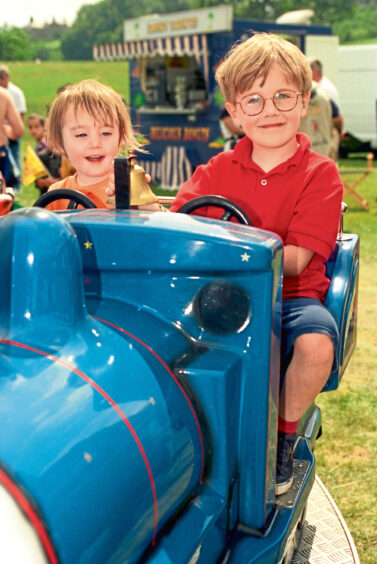 1996 - Having fun on one of the rides at the Stonehaven Games are Fergus Robertson, 5, and his sister Grace, 2