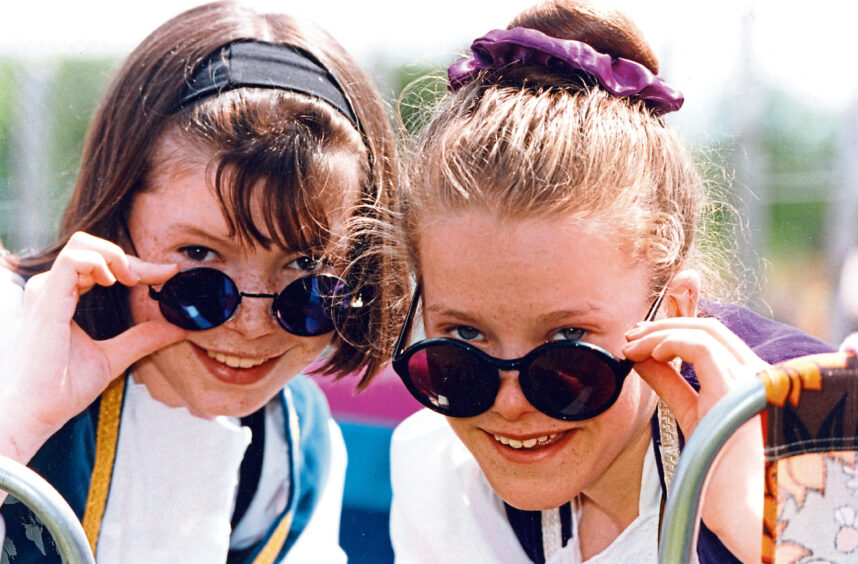 1993 - Young Highland dancers Julie Meston, left, Stonehaven, and Louisa Smith, Catterline, both 13, enjoy the sunshine before taking part in Aberdeen Highland Games