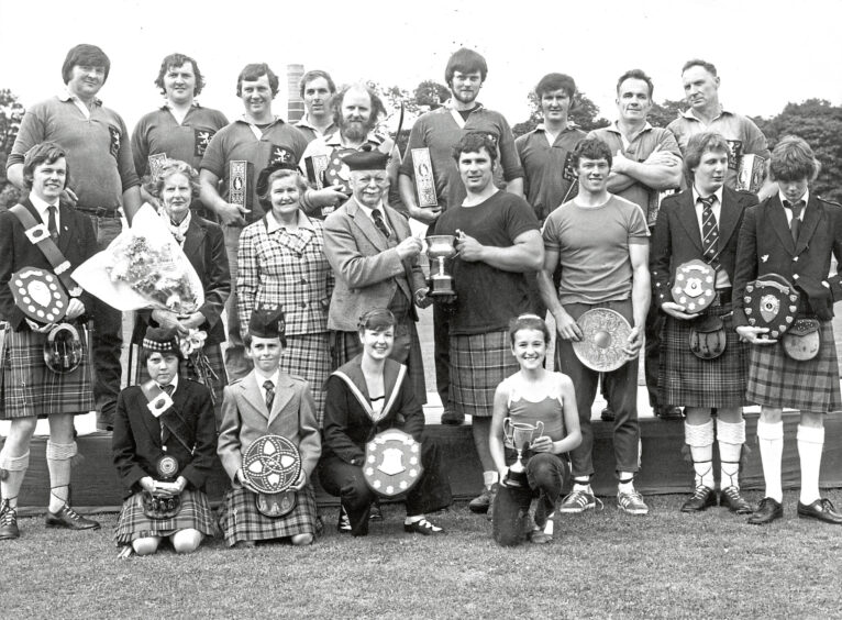 1980 - Chieftain of the Stonehaven Highland Games, the Earl of Kintore, presents the trophy to the heavy champion, George Donaldson, of Forfar