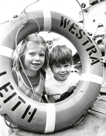 1986 - Aberdeen youngsters Joanna and Stephen Ratcliffe  explored the fisheries protection vessel Westra in  anticipation of the Fish Festival