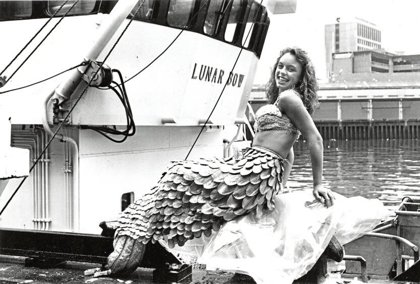 1989 - Aberdeen Fish Festival mermaid Donna Maclean surfaced  at the Neptune Quayside grading plant