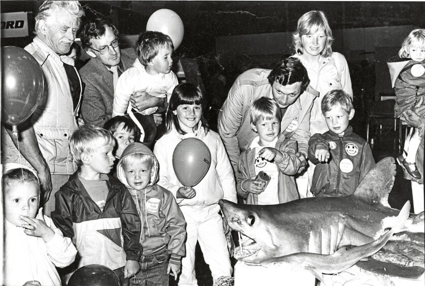 1985 - Some of the children at the festival are intrigued by 'Jaws'  as they sample shark and swordfish dishes at fishmonger  Ken Watmough's stand