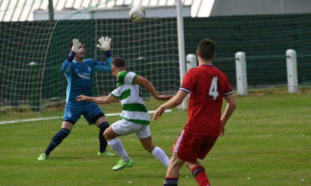 Scott Adams opens the scoring for Buckie against Aberdeen.