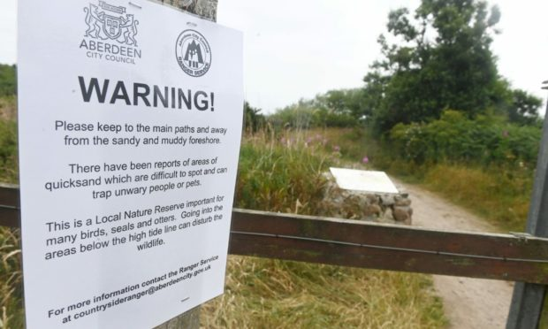 The warning sign at Deemouth. Picture by Chris Sumner