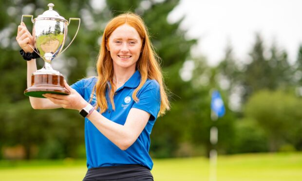 Aboyne's Carmen Griffiths celebrates with the trophy.