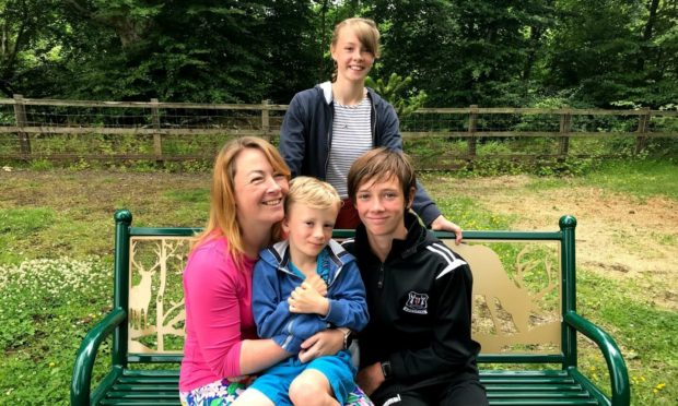 Esther Burns graduated from Aberdeen University after juggling with motherhood and a job as a nurse. Pictured: Esther Burns with her children Arwen, Zach and Paul.