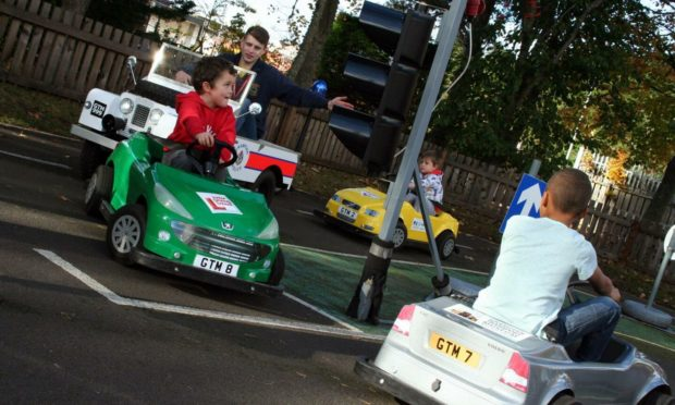 Kids learning how to drive at Grampian Transport Museum's junior driving school