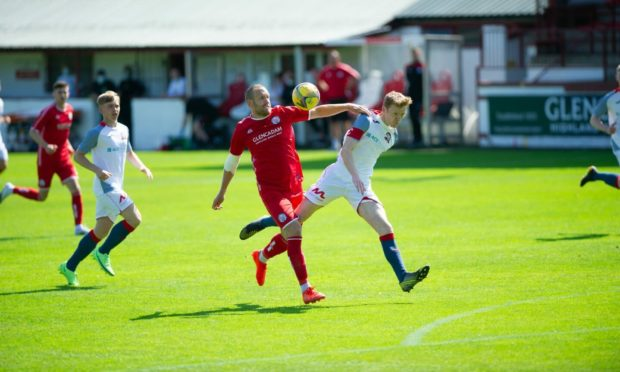 Brechin's Garry Wood, left, tries to get away from Turriff defender James Chalmers