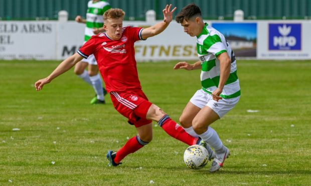 Max Barry, right, in action for Buckie Thistle against Aberdeen