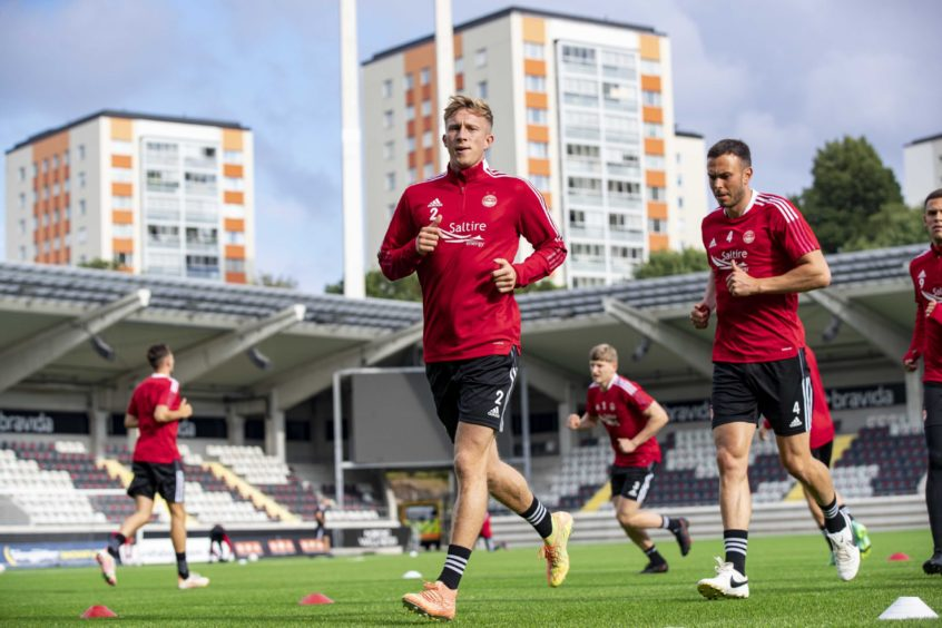 Ross McCrorie leads the way at Dons training in Gothenburg.