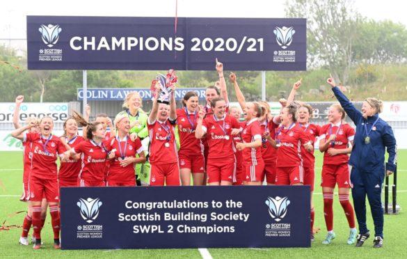 Aberdeen receive the SWPL2 trophy. Picture by Paul Glendell