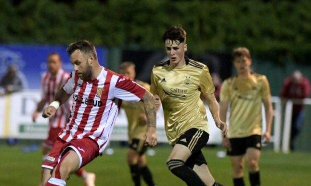 Kevin Hanratty, right, in action for Aberdeen against his new club, Formartine United