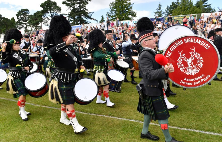 The 150th Aboyne Highland Games. The massed pipe band makes its way around the arena.    Picture by Kami Thomson