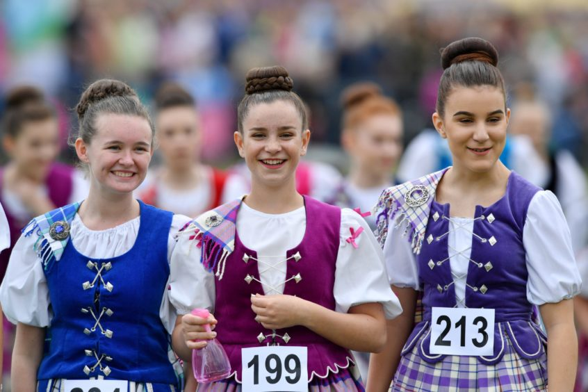 The 150th Aboyne Highland Games  Pictured - Highland dancers wait for the dompetition to start.    Picture by Kami Thomson