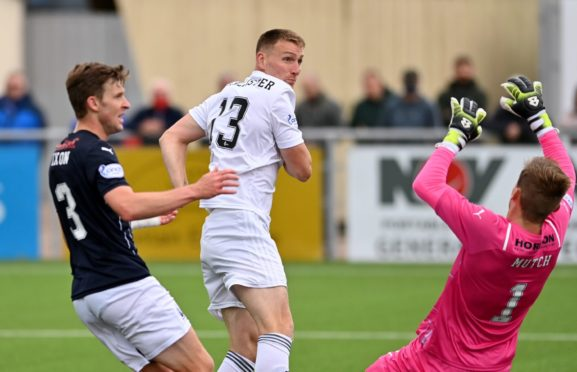 Rory McAllister turns in the equaliser for Cove Rangers.