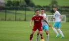 Aberdeen midfielder Scott Brown in action during the 1-1 friendly draw against Caley Thistle.  Supplied by Aberdeen FC