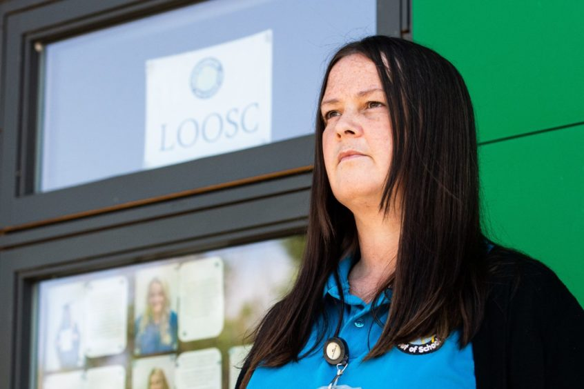 Laurencekirk out of school club manager Lisa Moggach wants council chiefs to rethink the charges.