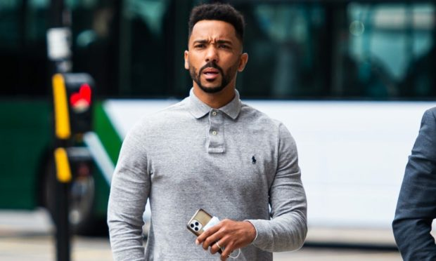 Shay Logan arrives at Aberdeen Sheriff Court to face charges of dangerous driving and drink driving