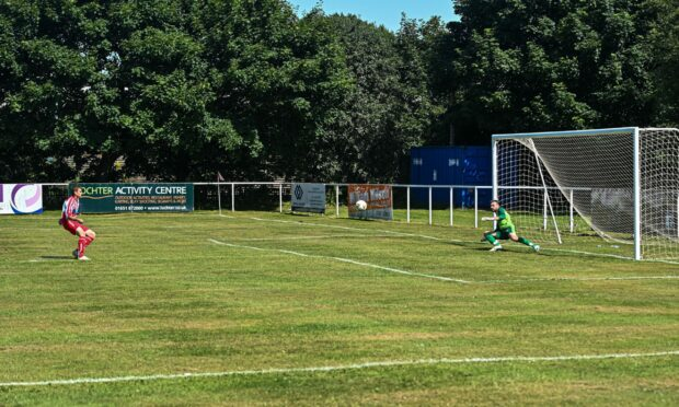 Graeme Cochrane extends the lead for Colony Park with a first half penalty.