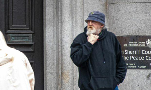 Bruce Harvey outside court.