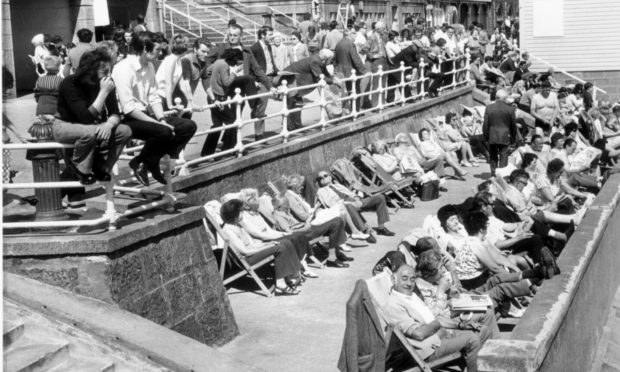 Young and old enjoy the sun at Aberdeen Beach during the 1973 Trades Fortnight
