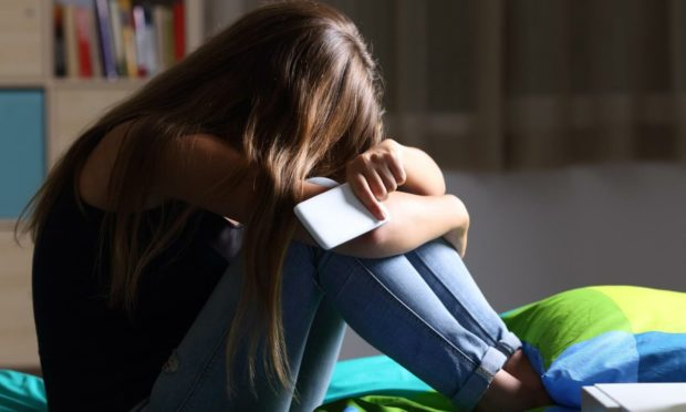 The lines between online and in-person bullying can become blurred for kids (Photo: Antonio Guillem/Shutterstock)