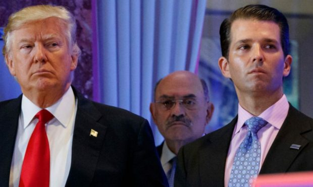 Donald Trump, left, his chief financial officer Allen Weisselberg, center, and his son Donald Trump Jr.