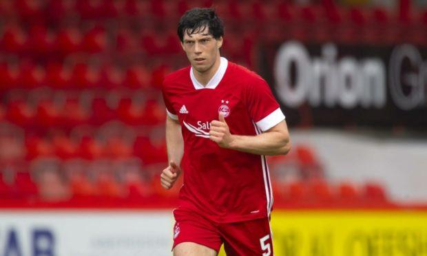 Scott McKenna playing for Aberdeen.