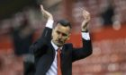 Aberdeen manager Stephen glass acknowledges the fans at Pittodrie.