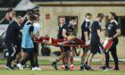 Aberdeen's Andy Considine is stretchered off injured against Qarabag in Azerbaijan.