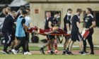 Aberdeen's Andy Considine is stretchered off injured  early in the Europa Conference League tie.