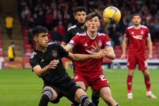 Aberdeen's Calvin Ramsay (right) competes with Turav Bayramov of Qarabag at Pittodrie.