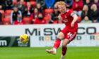 On loan Newcastle midfielder Matty Longstaff in action for Aberdeen against Ross County.