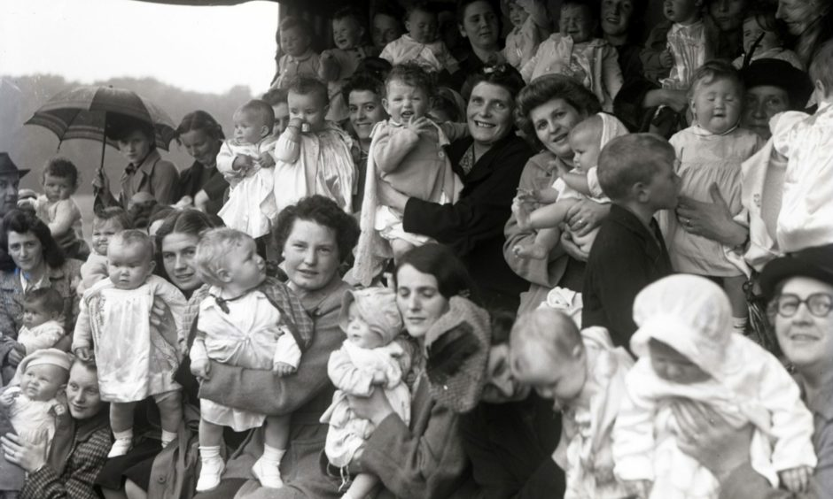 A beautiful baby contest in the rain during stay-at-home holiday week at Hazlehead Park in 1944.
