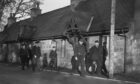Prisoners of war walking through Monymusk village square in 1945.