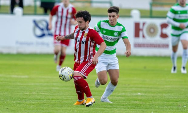 Formartine's Andrew Greig, left, tries to get away from Buckie's Max Barry