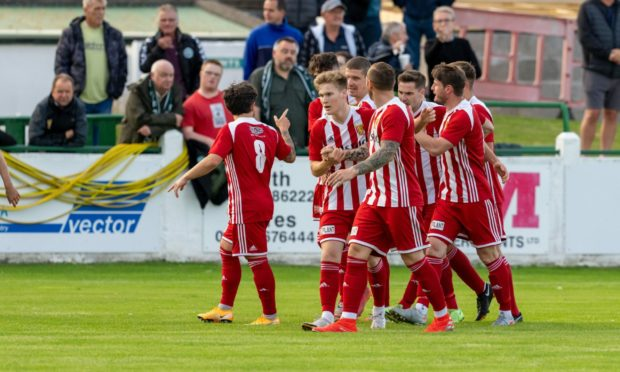 Formartine players celebrate Graeme Rodger's goal against Buckie in the Evening Express Aberdeenshire Cup