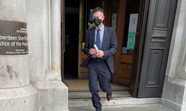 Neil Beattie leaving court.