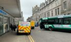 A car has collided with a bus on Bridge Street