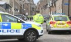 Police have remained at the scene for more than three hours as a cordon is placed on the street.
