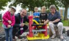 Laurence Findlay, Aberdeenshire Council's director of education and Gillian Owen, education committee chairwoman, with children at the new Fishermoss School nursery.