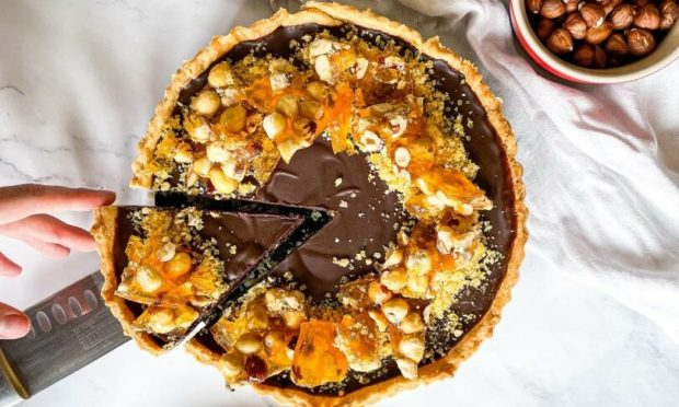 This Ferrero Rocher inspired chocolate and hazelnut tart will have you craving more.
