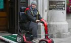 Mark Glen leaving court on his mobility scooter.
